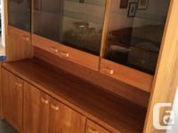 This teak hutch, with glass doors (upper), is a two