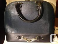 Selling hard case purse.    Teal body with black