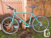 """Teal colour. 21 rate; 20"""" framework; Shimano Rapid-Fire"""