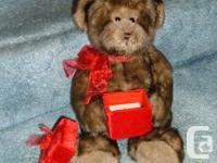 "This BIG PLUSH"" GUND"" TEDDY BEAR uses a red organza bow"