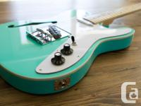 This is a kit guitar I assembled. I refretted it,