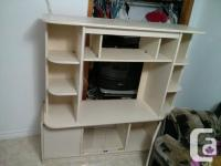 Costing $15. Tv stand or shelfing system. 2 cupboards.