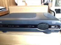 In the box, never used. PVR, Remote and Power Cable