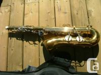 Old Bundy Tenor Sax with case.  Good tone,  New pads.