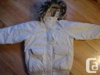 Light gray jacket with removable hair hood. Goose
