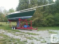 Thirty foot Kirby sailboat with full set of sails,