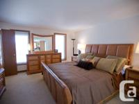 This Contemporary solid lumber bedroom suite by