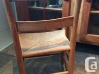 THREE LADDER BACK CANE CHAIRS. THE RUSH SEATS WERE