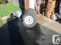 Three trail tires for sale ,  with White spoked rims