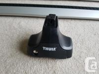 Like new Thule Aeroblade roof rack and 480R Rapid