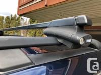 Great condition Thule roof rack bars off a Nissan
