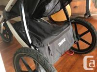 An all-terrain stroller with a sleek, lightweight