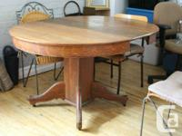 Antique dining table that seats 4-6 people for sale.
