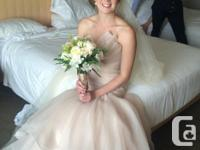 I am selling my Essence of Australia wedding gown in