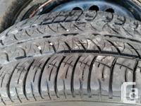 Set of four all season tires on rims Cooper CS4 touring