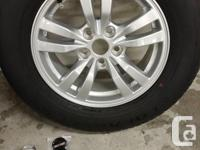 Set of Yokohama Geolandar 033 all season tires almost