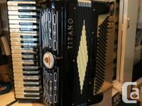 I'm selling a Titano Accordion with Case. Model Number
