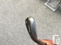 56 degree Vokey wedge. In decent shape, great wedge