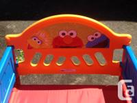 Sesame Street toddler bed. Bought new at ToysRUs for
