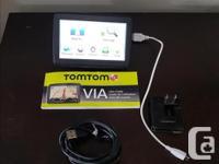 Tom Tom VIA 1500 GPS for sale. Comes with all