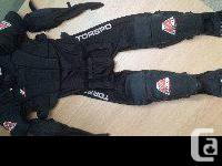 A one-piece suit with attached elbow pads, shin pads