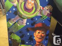 Toy Story themed bin storage unit. Wooden frame holds 9