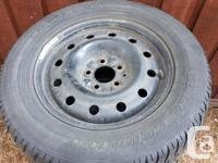 Set of 4 used winter tires (M+S), rims and hub caps. I