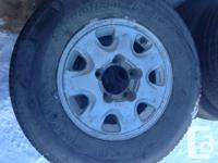 Set of four Suzuki Sidekick rims with mounted tires,