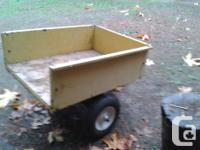 Tractor lawnmower dump trailer in good condition. New