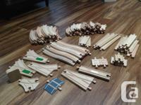 Collection of several wooden train sets all to be sold