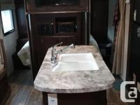 2015 Grey Wolf 24RB travel trailer by Forest River