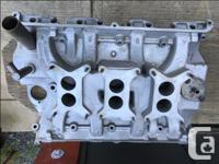 Original Ford Tri-power intake manifold and carbs.