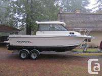 2005 Trophy 2359 fishing machine. Hardtop cabin, 24'