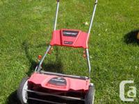 Troy-Bilt Revolution Silent Reel Lawnmower for sale.