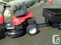 Troy-Built 30'' riding mower with trailer. A couple