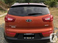 Make Kia Model Sportage Year 2012 Colour Orange kms