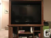 Large solid wood TV entertainment cabinet. In excellent
