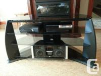 Selling glass TV stand with four shelves for TVs up to