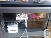 tv stand with wheels, color black. Nice for a small tv,
