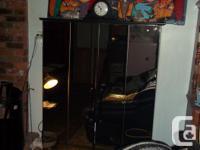 Beautiful Black TV / Wardrobe with Mirrored Doors as