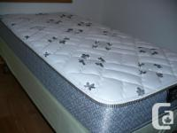 Twin bed mattress boxspring and frame. Custom extra