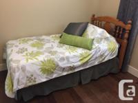 Two twin beds with solid maple Roxton head boards.