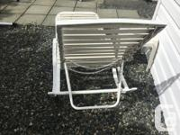 Two lounge chairs with adjustable backs. Includes two