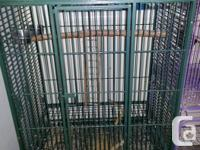 1. Large (colour green) bird/parrot cage on wheels