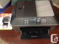 2 color printers available for sale. One Canon MX870