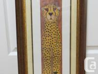 Two complementary African animal prints (glass framed)