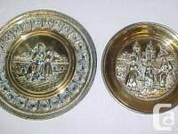 Available for sale are Two Tooled Metal Dutch Scenes