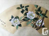 These two oriental floral prints are in matching wood