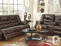 Hardly used brown leather dual motion reclining couch