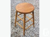 The first of these work stools is antique, classic